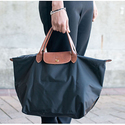 Neiman Marcus: $100 OFF $400 with Longchamp Purchase